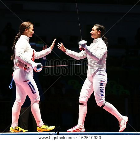 RIO DE JANEIRO, BRAZIL - AUGUST 8, 2016: Sofya Velikaya (L) and Yana Egorian of Russia after final in the Women's individual sabre of the Rio 2016 Olympic Games at the Carioca Arena 3