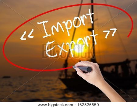 Woman Hand Writing Import - Export With A Marker Over Transparent Board.