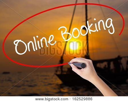 Woman Hand Writing  Online Booking  With A Marker Over Transparent Board
