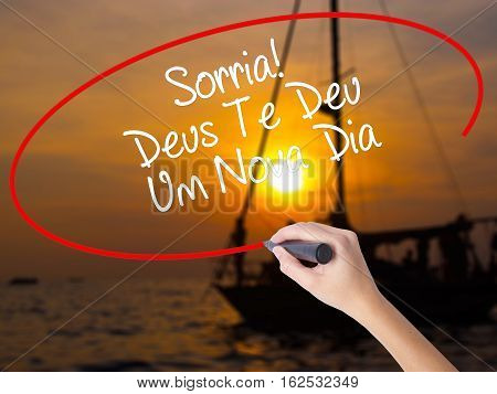 Woman Hand Writing Sorria! Deus Te Deu Um Novo Dia (smile! God Gives You Another Day In Portuguese)