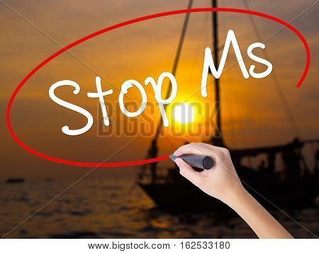 Woman Hand Writing Stop Ms With A Marker Over Transparent Board