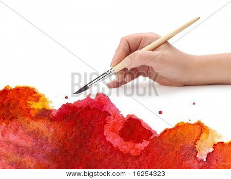 hand with brush and paint