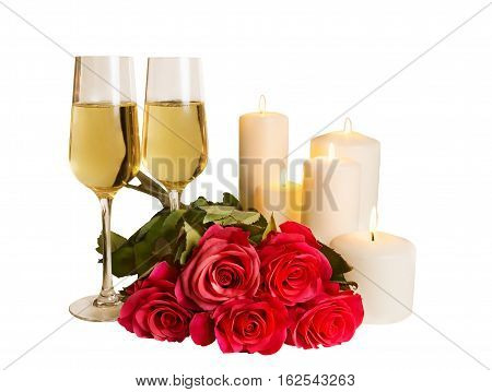 Champagne roses and candles isolated on white background