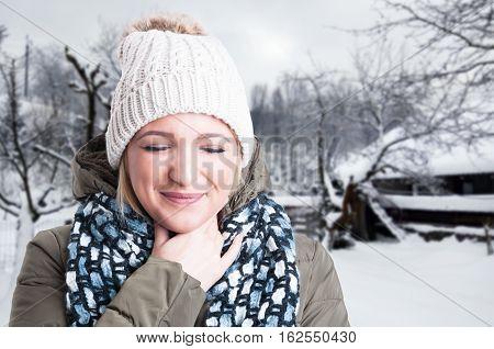 Closeup Portrait Of Beautiful Blonde Having Sore Throat