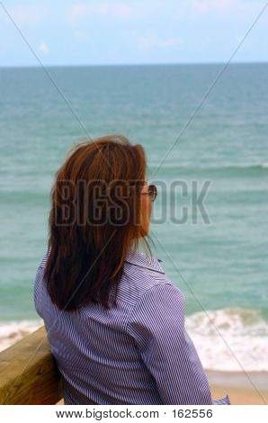 Lonely Woman On Beach