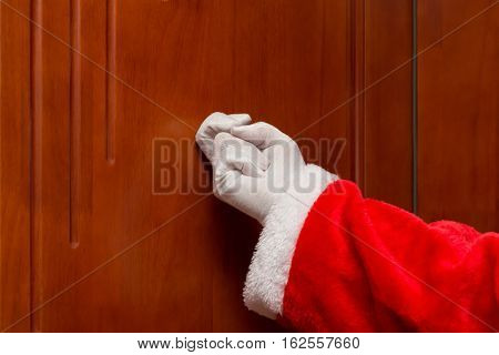 Santa Claus knocking the door horizontal composition