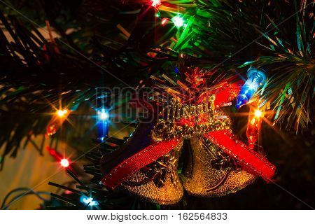 extreme closeup decorated Christmas tree at home with lights background