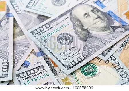 american hundred dollar bills background. One hundred dollar bills in U.S. currency on white background.