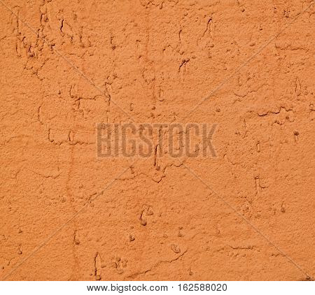 Plaster, plaster yellow color on a concrete wall. Stucco ochre wall background or texture. Plaster, plaster texture, plaster background. Yellow wall. Terracota color wall. Terracotta wall.