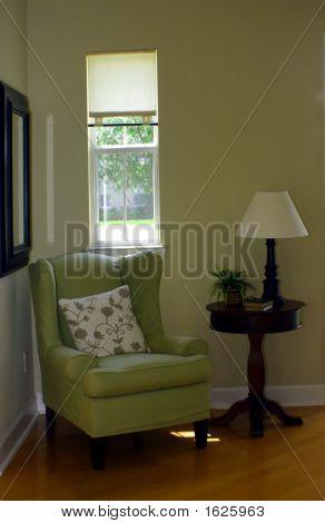 Green Wingback Chair And Lamp In Foyer