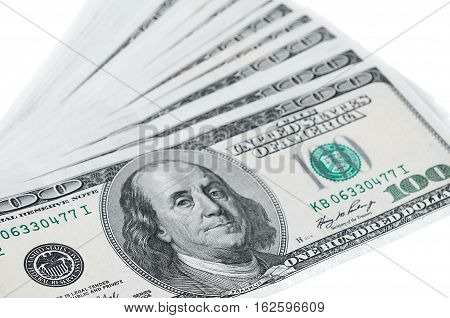dollars on white background. One hundred dollar bills in U.S. currency on white background.