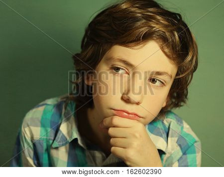 preteen handsome boy think over difficult issue close up pprtrait
