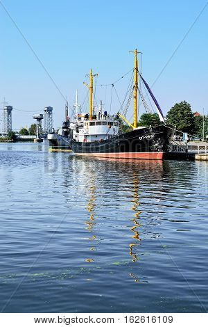 KALININGRAD, RUSSIA - SEPTEMBER 18, 2012: Ships and submarine berthed at the quay of Peter the Great. The tourist attraction of the city, favorite vacation spot townspeople