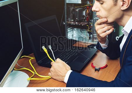 Man In Suit Holding Network Cables Concept Is The Connection