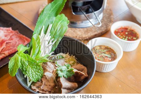 Noodle and Beef Hot Pot Vietnamese Food with steam.