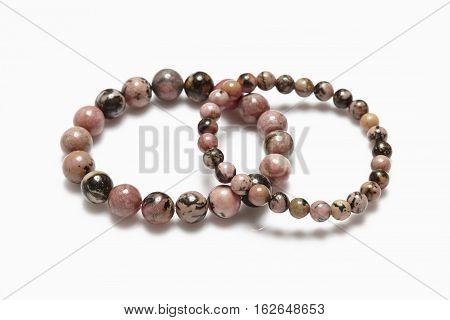 Lucky brown stone bracelet on white background.