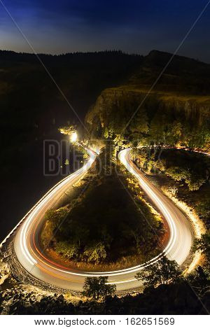 Horseshoe Roadway At Night With Light Trails In Rowena Crest, Oregon.