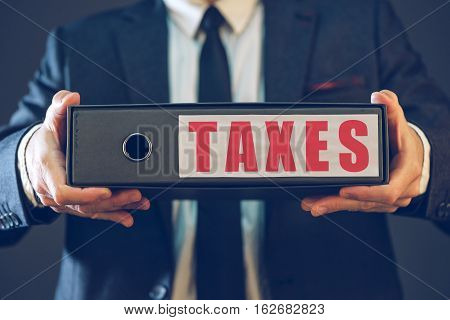 Businessman with tax document ring binder corporate accountant archiving business documentation