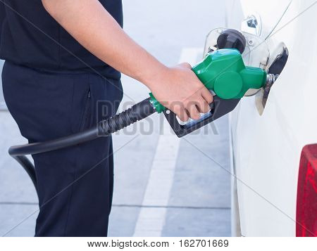 Man Handle Fuel Nozzle To Refuel.  In Gas Station.