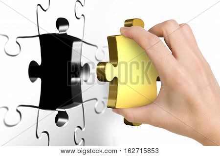Hand Holding Last Missing Golden Puzzle Piece