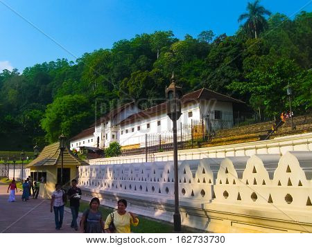 Kandy, Sri Lanka - May 02, 2009: The people going to Temple Of The Sacred Tooth Relic, located in the Royal Palace Complex Of The Former Kingdom Of Kandy, Sri Lanka on May 02, 2009