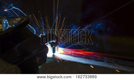 welder craftsman erecting technical steel Industrial steel welder in factory technical