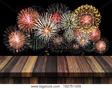 Abstract empty wooden floor with fireworks background. colorful fireworks over dark sky abstract for background. New Year celebration fireworks.