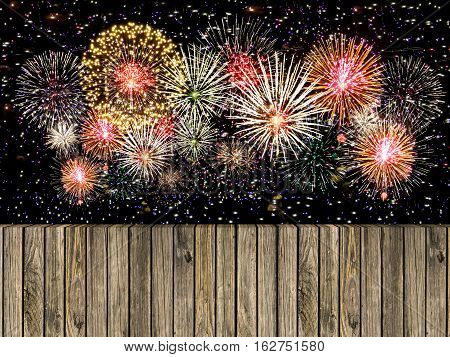 Abstract wooden floor with fireworks background. colorful fireworks over dark sky abstract for background. New Year celebration fireworks.