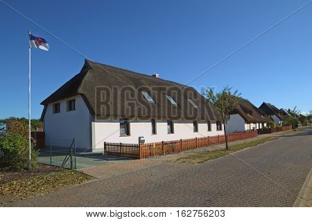 Thatched Houses In Hanshagen, Mecklenburg-west Pomerania, Germany. On The Left The Flag Of Western P