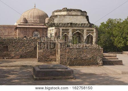 MANDU, MADHYA PRADESH, INDIA - NOVEMBER 18, 2008: Ancient islamic palace of Ashrafi Mahal in Mandu, Madhya Pradesh, India. 15th Century AD