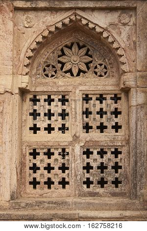MANDU, MADHYA PRADESH, INDIA - NOVEMBER 18, 2008: Detail of stone window of Darya Khan's tomb in the hilltop fortress of Mandu. 16th Century AD