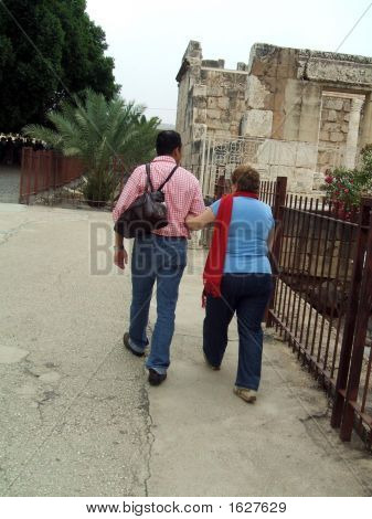 Man And Woman Walking Towards Historical Place
