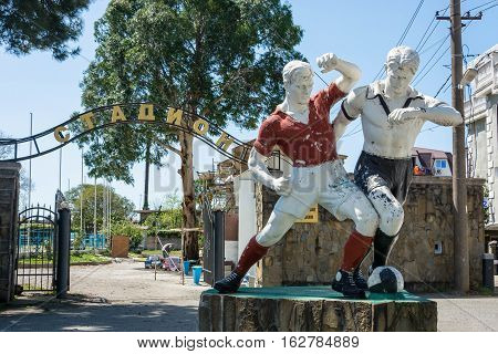 Old Sculpture Of Two Football Players At The City Stadium In Gagra, Abkhazia, 15 April, 2016.