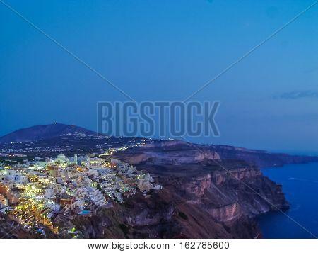Lights Of Fira Village At Night In Santorini