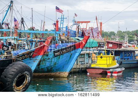 Labuan,Malaysia-Dec 23,2016:Commercial fishing boats in Labuan island harbor,Labuan,Malaysia.The fishing industry contributes a significant income to islanders here.