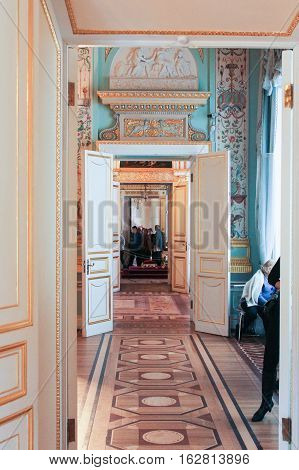 Gatchina, Russia - 3 December, A group of visitors in transit, 3 December, 2016. Visit the Museum Reserve Gatchina Palace.
