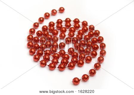 Arrangement Of Red Beads On White Background