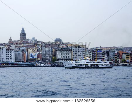 Istanbul Turkey - July 26 2016: Ship in Bosporus with Galata Tower background. The ferry is one of the oldest means of transportation in Istanbul as the city is naturally separated by the Bosphorus strait and surrounded by sea. Although the ferries have b