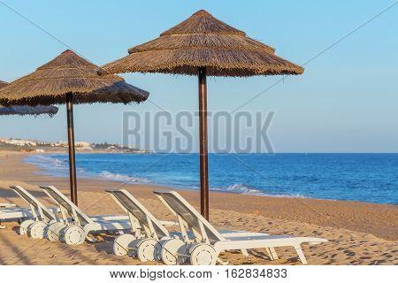 Sun beds on the coast of Portugal in the Algarve. Vila Moura.