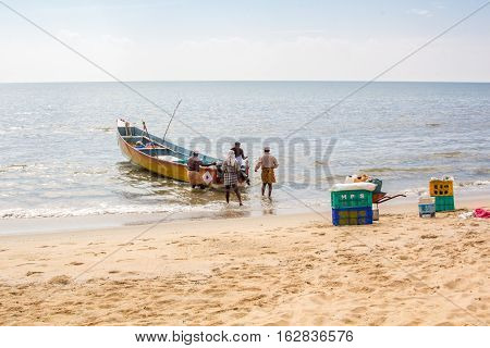 Fisherman going for their works on the seashore Kerala India