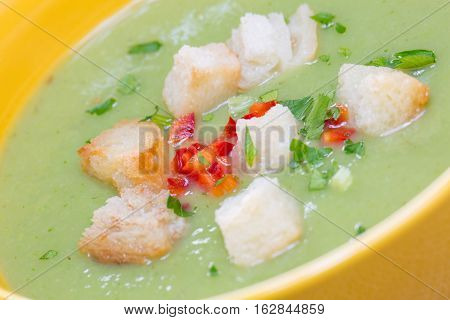 Close Up With Green Pea Cream Soup And Bread Crumbs