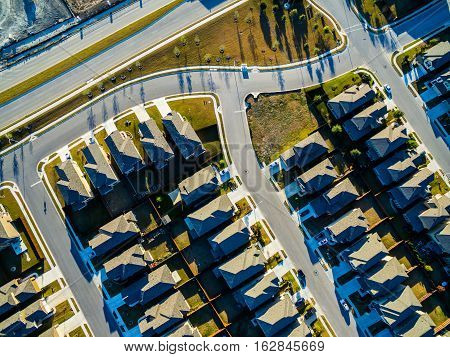 Afternoon Sunny Looking Straight down above Suburban Homes North of Austin near Round Rock , Texas as Texas expands more and more homes are built in Modern Neighborhood Communities Bird's Eye View row after row of Cookie Cutter Houses