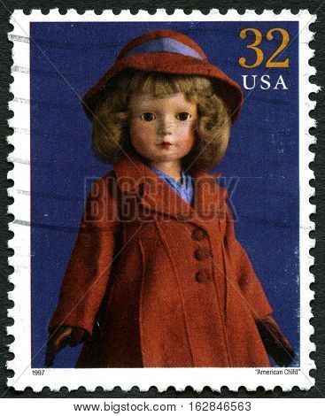 UNITED STATES OF AMERICA - CIRCA 1997: A used postage stamp from the USA depicting an image of a traditional doll called the American Child circa 1997.