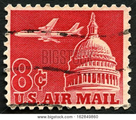 UNITED STATES OF AMERICA - CIRCA 1962: A used Air Mail postage stamp from the USA depicting an image of the Capitol building and a transport plane circa 1962.
