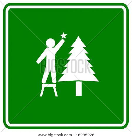 placing a star in a christmas tree sign