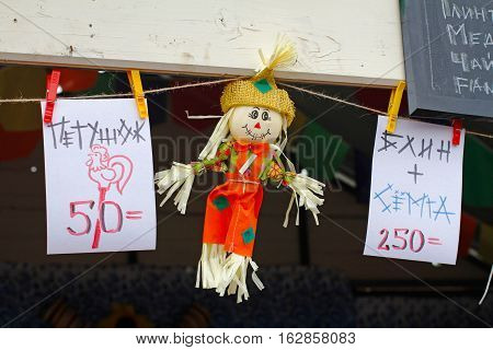 Moscow Russia - March 12 2016: Scarecrow and price tags (translated from the Russian