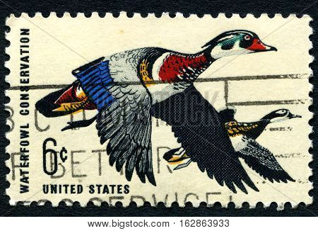 UNITED STATES OF AMERICA - CIRCA 1968: A postage stamp from the USA depicting an illustration of Wood Ducks and promoting Waterfowl Conservation circa 1968.