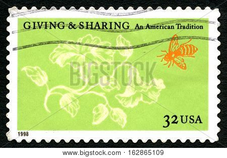 UNITED STATES OF AMERICA - CIRCA 1998: A used postage stamp from the USA celebrating the concept of Giving and Sharing and kindness circa 1998.