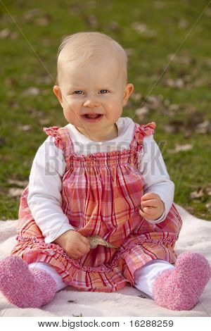 laughing one year old baby girl