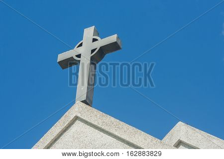 Symbol of a church cross. Christianity religion symbol with vintage effect.